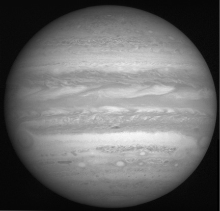 This image of Jupiter is produced from a 2x2 mosaic of photos taken by the New Horizons Long Range Reconnaissance Imager (LORRI): 236 KB; click on the image to view the original website