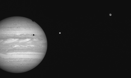 Long Range Reconnaissance Imager took this 4-millisecond exposure of Jupiter and two of its moons at 01:41:04 UTC on January 17, 2007: 96 KB; click on the image to view the original website